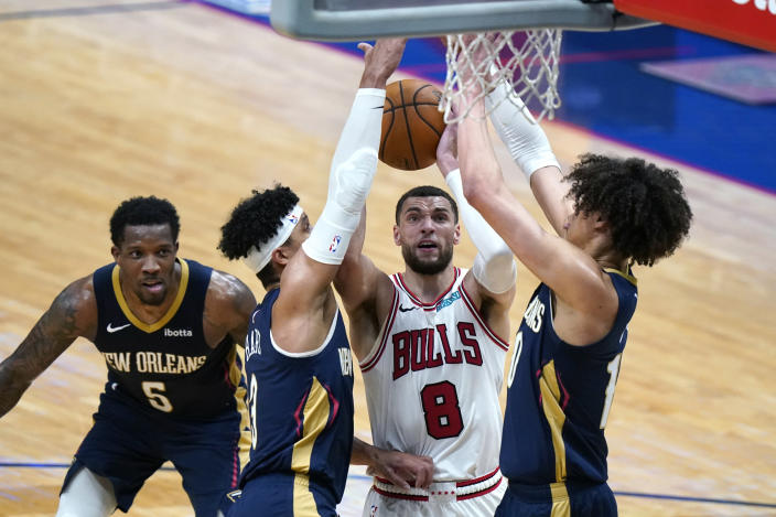 Chicago Bulls guard Zach LaVine (8) goes to the basket between New Orleans Pelicans center Jaxson Hayes, left, and guards Josh Hart and Eric Bledsoe (5) in the second half of an NBA basketball game in New Orleans, Wednesday, March 3, 2021. (AP Photo/Gerald Herbert)