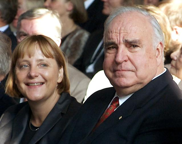 <p>Former German Chancellor Helmut Kohl (R) sits next to Christian Democrat party (CDU) leader Angela Merkel (L) during celebrations to mark the 10th anniversary of German unification in Berlin September 27, 2000. (Michael Urban/Reuters) </p>