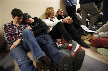 Tarah Camarillo (L-R), her partner Nicole Barnes, Leighton Hilburn and his partner Preston Perry wait in line with hundreds of other people to apply for a marriage license at the Salt Lake County Clerks office in Salt Lake City, Utah, December 23, 2013. REUTERS/Jim Urquhart