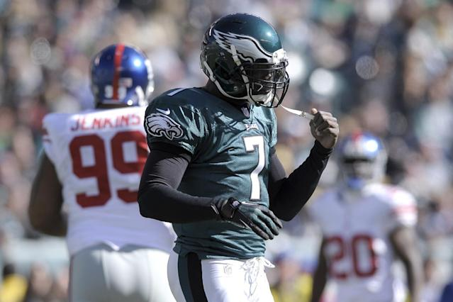 Philadelphia Eagles quarterback Michael Vick (7) reacts after being sacked during the first half of an NFL football game New York Giants Sunday, Oct. 27, 2013, in Philadelphia. (AP Photo/Michael Perez)
