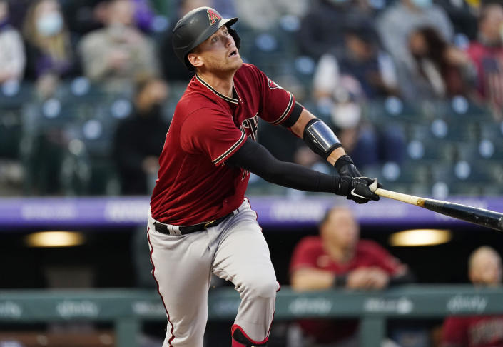 Arizona Diamondbacks' Carson Kelly watches his double off Colorado Rockies starting pitcher Antonio Senzatela during the third inning of a baseball game Wednesday, April 7, 2021, in Denver. (AP Photo/David Zalubowski)