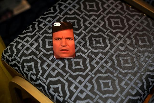 <p>An iPhone case with Tucker Carlson's face is left in a chair during the Conservative Political Action Conference at the Gaylord National Resort and Convention Center, Feb. 23, 2018 in National Harbor, Md. (Photo: Chip Somodevilla/Getty Images) </p>