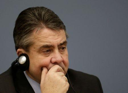 German Foreign minister Gabriel listens during a news conference in Riga