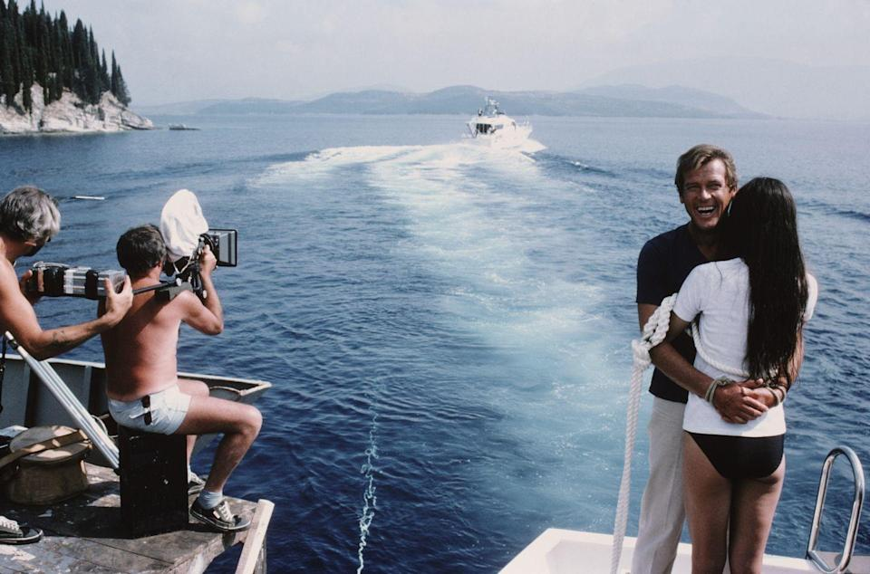 <p>Roger Moore and Carole Bouquet on the set of 'For Your Eyes Only', 1981. Here they are tied together in readiness for a scene in which they are dragged through shark-infested waters. </p>