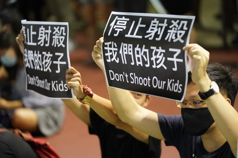 Residents of Tsuen Wan gather at an open air stadium to protest a teenage demonstrator shot at close range in the chest by a police officer in Hong Kong, Wednesday, Oct. 2, 2019. Hong Kong office workers and schoolmates of the teenage demonstrator rallied Wednesday to condemn police tactics and demand accountability. (AP Photo/Vincent Thian)