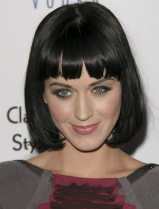 "<div class=""celebname""><a target=""_blank"" href=""/virtual-makeover/celebrity-hairstyles/katy-perry/"">Ur So Gay</a>                                                   </div><!--  Slide Title  -->                                                                                                    <p>                                                     <span class=""infotext"">While the songstress has always been partial to thick black eyeliner she has been less than consistent when it comes to her hairstyles. This <a href=""/hairstyles/short/"">short haircut</a> with straight <a href=""/blogs/"">bangs</a> was one of Perry's less frequent looks. <br></span>                                                     <br>                                                        <a target=""_blank"" href=""/virtual-makeover/celebrity-hairstyles/katy-perry/"" class=""callout"">Try on Katy Perry's hairstyles in the Makeover Studio!</a><!--  Slide Link  -->                                                     <br>                                                        <br>                                                    </p>"