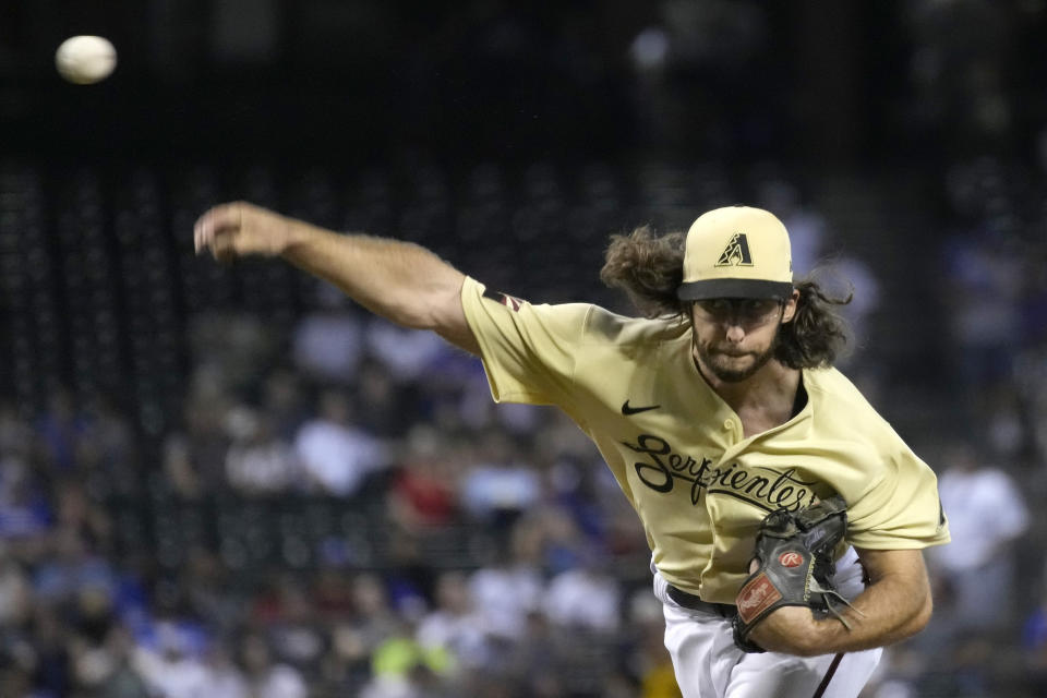 Arizona Diamondbacks pitcher Zac Gallen throws against the Los Angeles Dodgers in the first inning during a baseball game, Friday, July 30, 2021, in Phoenix. (AP Photo/Rick Scuteri)