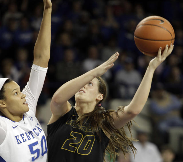 Missouri's Kayla McDowell (20) shoots under pressure from Kentucky's Azia Bishop (50) during the first half of an NCAA college basketball game, Sunday, Jan. 12, 2014, in Lexington, Ky. (AP Photo/James Crisp)