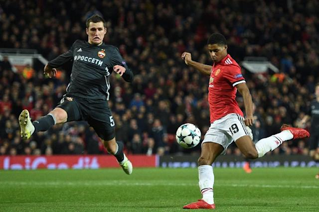 Manchester United's striker Marcus Rashford (R) shoots under pressure from CSKA Moscow's defender Viktor Vasin (L) to score their second goal during the UEFA Champions League Group A football match December 5, 2017 (AFP Photo/Oli SCARFF )