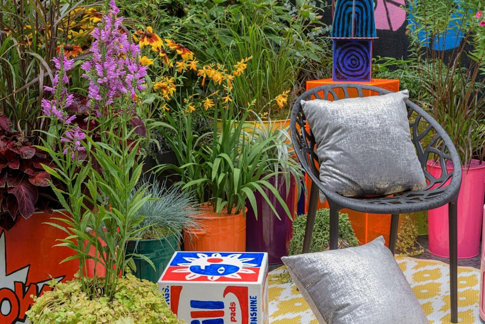"""<p>It's not hard to miss the Pop Street Container Garden when you're walking past. Taking inspiration from pop and street art, it's a place designed to hang out with friends over a good drink. As well as including energising plants, the garden contains original sculptures and a mural by artist Robert Littleford. </p><p><strong>READ MORE</strong>: <a href=""""https://www.countryliving.com/uk/news/a34460466/chelsea-flower-show-2021/"""" rel=""""nofollow noopener"""" target=""""_blank"""" data-ylk=""""slk:RHS Chelsea Flower Show 2021: Dates, tickets and garden highlights"""" class=""""link rapid-noclick-resp"""">RHS Chelsea Flower Show 2021: Dates, tickets and garden highlights</a></p>"""