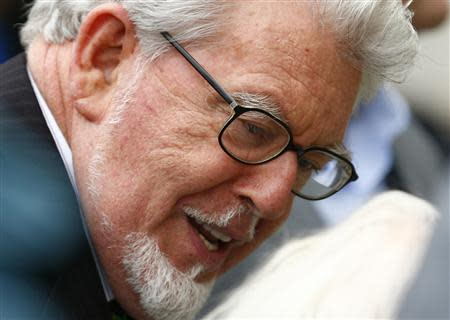Entertainer Rolf Harris arrives at Westminster Magistrates Court, to face sex offence charges, in central London