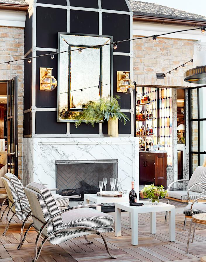 The terrace chairs wear a striped fabric from Rose Tarlow. Light fixtures by Urban Archaeology; custom mirror.