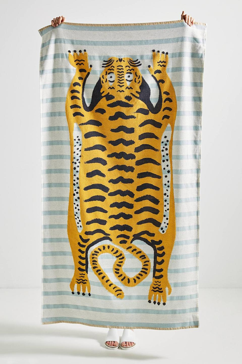 """<p><strong>Anthropologie</strong></p><p>anthropologie.com</p><p><strong>$54.00</strong></p><p><a href=""""https://go.redirectingat.com?id=74968X1596630&url=https%3A%2F%2Fwww.anthropologie.com%2Fshop%2Ftiger-beach-towel&sref=https%3A%2F%2Fwww.cosmopolitan.com%2Flifestyle%2Fg26323465%2Fbest-beach-towels%2F"""" rel=""""nofollow noopener"""" target=""""_blank"""" data-ylk=""""slk:Shop Now"""" class=""""link rapid-noclick-resp"""">Shop Now</a></p><p>This beauty mixes a timeless stripe with a wild tiger drawing. It's kinda like your vibe classic, but a little scary.</p>"""