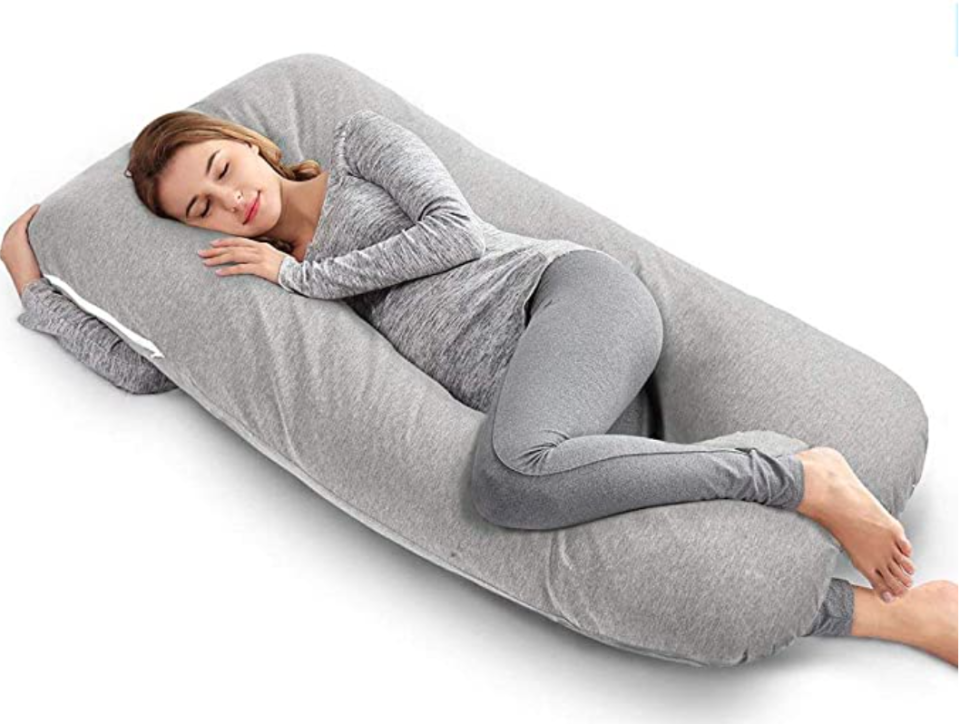 woman lying with a pregnancy pillow
