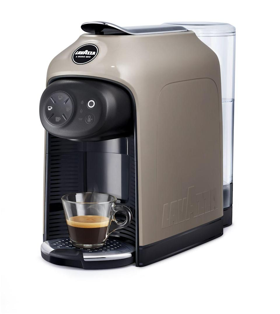 """<p>Espresso lungo or ristretto, Lavazza's compact Idola coffee machine lets you prepare all types of coffee at the touch of a button. The fine no-mess machine just about slots into anywhere in the home and delivers shots that pack in the punch of a barista-made roast – the perfect way to start his day.</p><p>£139, <a href=""""https://www.lavazza.co.uk/en/coffee-machines/idola.html"""" rel=""""nofollow noopener"""" target=""""_blank"""" data-ylk=""""slk:Lavazza"""" class=""""link rapid-noclick-resp"""">Lavazza</a>.</p>"""