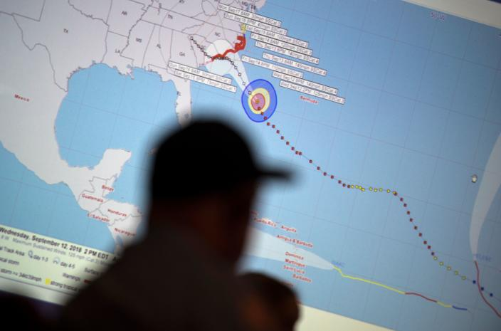 <p>Emergency workers monitor hurricane progress and prepare for the landing at the Emergency operations center a day before the arrival of hurricane Florence in Wilmington, N.C., on Sept. 12, 2018. (Photo by Andrew Caballero-Reynolds/AFP/Getty Images) </p>