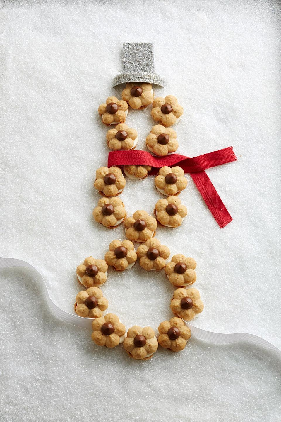 These easy spritz cookies will remind you of sitting around a campfire. Mini milk chocolate kisses are the perfect topper for these yummy Christmas cookies.