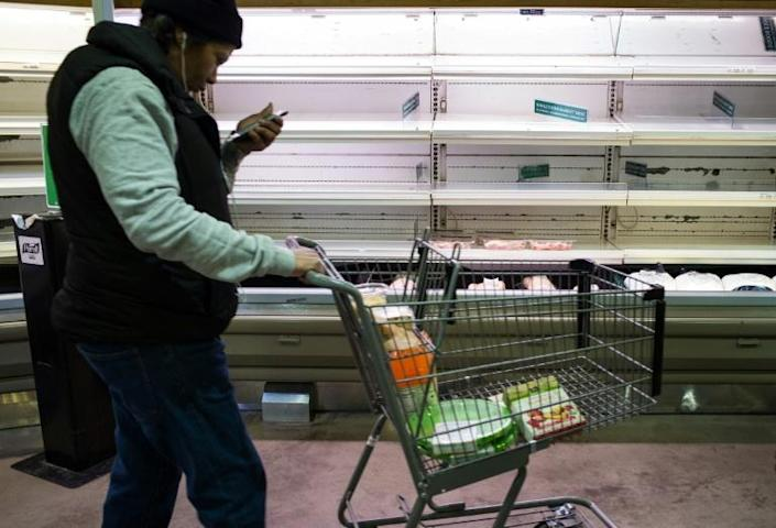 The meat sections of supermarkets have been near empty at times during the pandemic, such as in this store in Maryland on March 16, 2020 (AFP Photo/MANDEL NGAN)