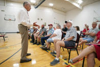 In this June 30, 2021, photo Sen. Chuck Grassley, R-Iowa, left, speaks to local residents during a town hall meeting in Ida Grove, Iowa. (AP Photo/Charlie Neibergall)