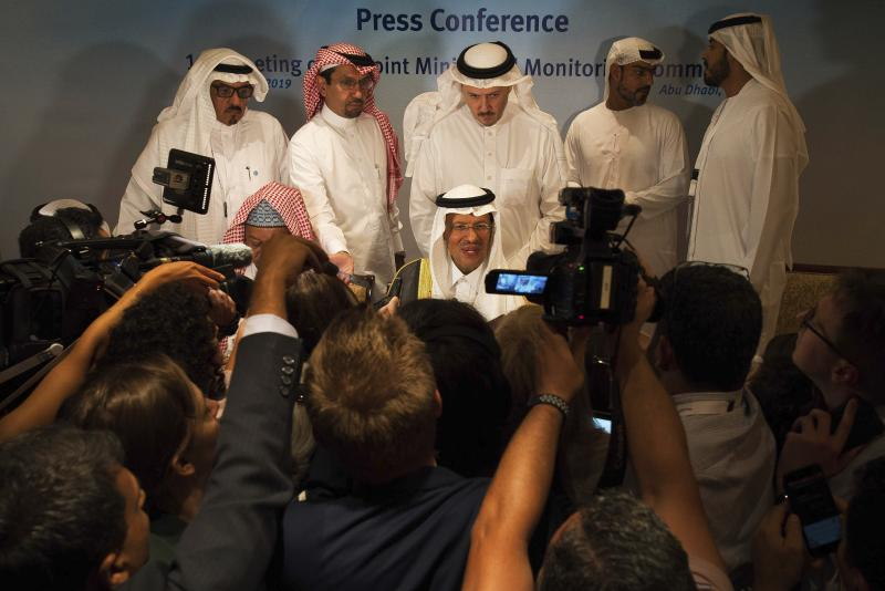 "Saudi Energy Minister Prince Abdulaziz bin Salman speaks to journalists after a news conference that followed an OPEC meeting in Abu Dhabi, United Arab Emirates, Thursday, Sept. 12, 2019. OPEC's Joint Ministerial Monitoring Committee met Thursday in Abu Dhabi as estimates of lowered crude oil demand in 2020 have the cartel considering additional production cuts. Before the meeting started, Prince Abdulaziz again called for ""cohesiveness"" in OPEC. (AP Photo/Jon Gambrell)"