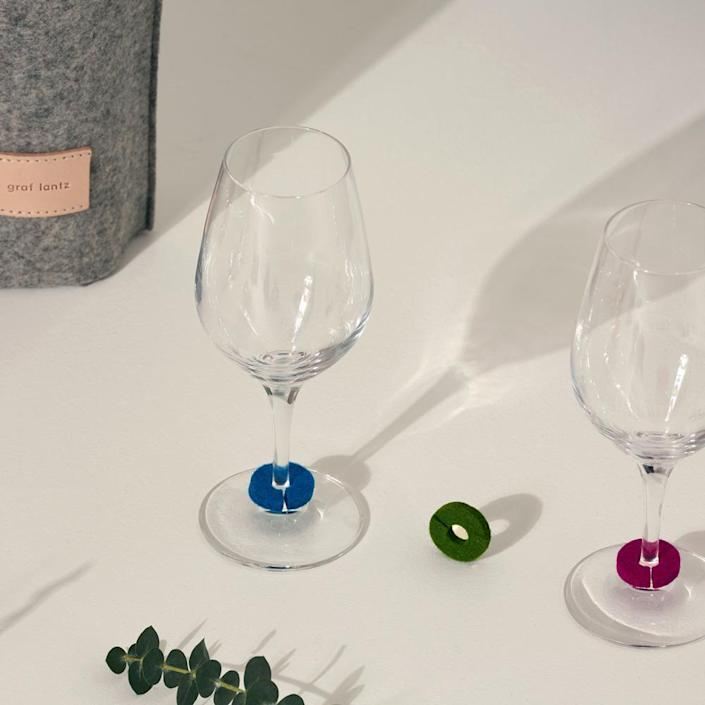 """These days I feel particularly cautious when it comes to sipping from the correct glass. I like investing in nicer wine glasses that I refuse to mark up, so I'm very excited about these cute, colorful felt rings to make glass identification easy. $19, Goodee. <a href=""""https://www.goodeeworld.com/collections/tabletop/products/wine-os-round-glass-markers"""" rel=""""nofollow noopener"""" target=""""_blank"""" data-ylk=""""slk:Get it now!"""" class=""""link rapid-noclick-resp"""">Get it now!</a>"""