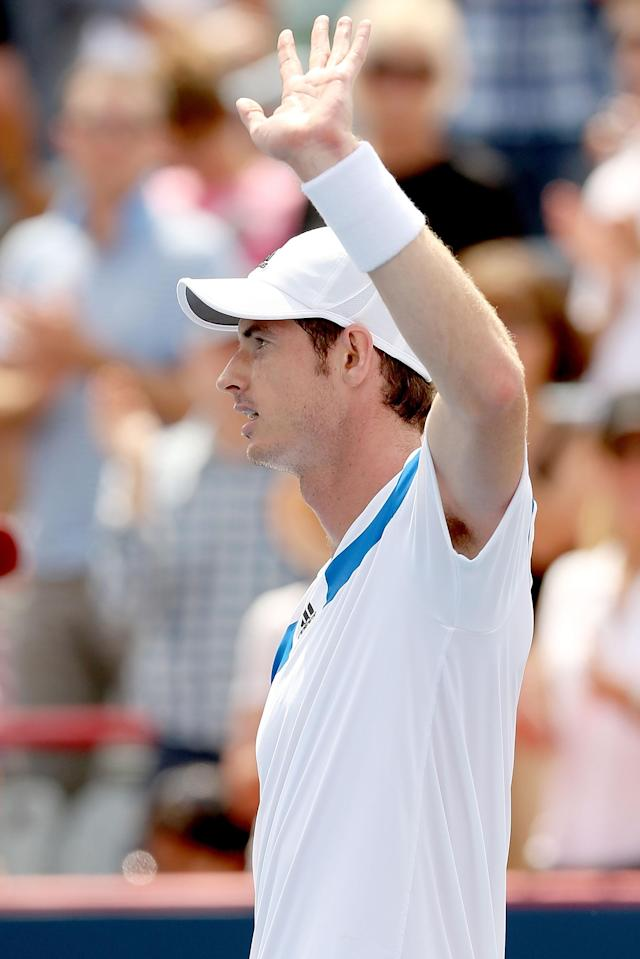 MONTREAL, QC - AUGUST 07: Andy Murray of Great Britain acknowledges the crowd after his win over Marcel Granollers of Spain during the Rogers Cup at Uniprix Stadium on August 7, 2013 in Montreal, Quebec, Canada. (Photo by Matthew Stockman/Getty Images)