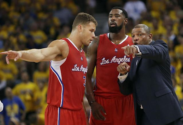 Los Angeles Clippers head coach Doc Rivers, right, gestures as he talks with forward Blake Griffin, left, and center DeAndre Jordan during the first half of Game 6 of an opening-round NBA basketball playoff series against the Golden State Warriors in Oakland, Calif., Thursday, May 1, 2014. (AP Photo/Marcio Jose Sanchez)