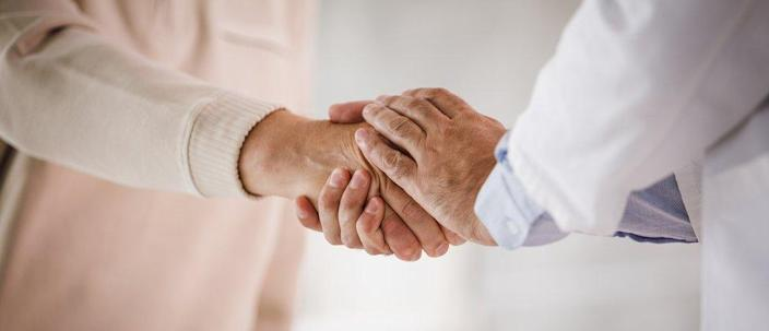 A patient with Parkinson's shaking a doctor's hand (stock image)