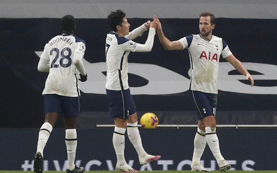 Tottenham's Harry Kane (R) celebrates with team mates after scoring the 1-0 lead during the English Premier League soccer match between Tottenham Hotspur and Fulham  - Shutterstock