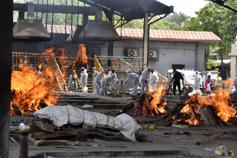 NEW DELHI, INDIA  APRIL 23: A view of multiple funeral pyres of Covid-19 victims, at Nigambodh Ghat crematorium, on April 23, 2021 in New Delhi, India. (Photo by Sanjeev Verma/Hindustan Times via Getty Images)