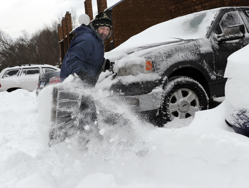 Richard Effinger, 43, digs his truck out from the snow Saturday morning, Feb. 9, 2013 in Danbury, Conn. A behemoth storm packing hurricane-force wind gusts and blizzard conditions swept through the Northeast overnight. (AP Photo/The News-Times, Carol Kaliff) MANDATORY CREDIT: THE NEWS-TIMES, CAROL KALIFF