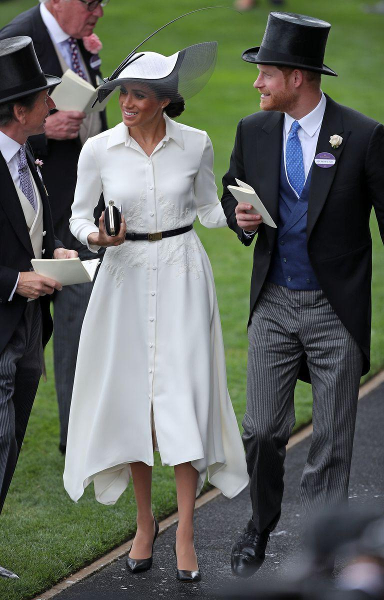 """<p>The Duchess wears a <a href=""""https://www.net-a-porter.com/gb/en/Shop/Designers/Givenchy?pn=1&npp=60&image_view=product&dScroll=0"""" rel=""""nofollow noopener"""" target=""""_blank"""" data-ylk=""""slk:Givenchy"""" class=""""link rapid-noclick-resp"""">Givenchy</a> dress teamed with a <a class=""""link rapid-noclick-resp"""" href=""""https://www.farfetch.com/uk/shopping/women/givenchy-logo-buckle-belt-item-12879589.aspx?storeid=9752&size=23&pid=googleadwords_int&af_channel=Search&c=629762120&af_c_id=629762120&af_keywords=aud-369354889887%3Apla-415898322905&af_adset_id=9623507496&af_ad_id=61199800056&is_retargeting=true&gclid=EAIaIQobChMIxIHy1PHf2wIVzxSPCh2zQAu_EAQYASABEgK9efD_BwE"""" rel=""""nofollow noopener"""" target=""""_blank"""" data-ylk=""""slk:Givenchy black belt"""">Givenchy black belt</a>, a black clutch bag, matching court shoes <a class=""""link rapid-noclick-resp"""" href=""""https://www.mappinandwebb.com/Birks-P%C3%A9tale-Large-Yellow-Gold-and-Diamond-Stud-Earrings/p/37510192/"""" rel=""""nofollow noopener"""" target=""""_blank"""" data-ylk=""""slk:Birks Pétale yellow gold and diamond stud earrings"""">Birks Pétale yellow gold and diamond stud earrings</a> and a Philip Treacy hat to Ascot.</p>"""