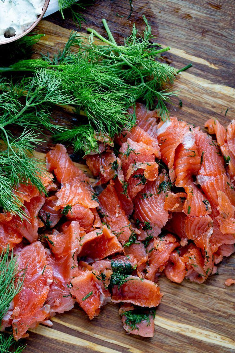 """<p>Gravlax is one of those fancy-seeming foods that's actually pretty easy to make at home—you just need a little patience! This method involves curing the fish for two or three days with a simple rub of lemon, salt, sugar, and dill.</p><p><strong>Get the recipe from <a href=""""https://www.thepioneerwoman.com/food-cooking/recipes/a99035/how-to-make-gravlax/"""" rel=""""nofollow noopener"""" target=""""_blank"""" data-ylk=""""slk:Natalie Perry"""" class=""""link rapid-noclick-resp"""">Natalie Perry</a>.</strong> </p>"""