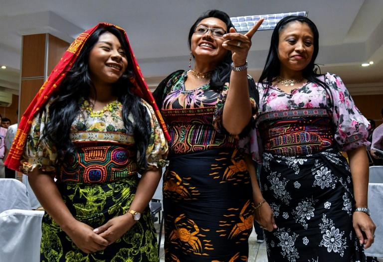 Guna indigenous women from Panama wearing traditional Mola designs at a press conference in Panama City to raise awareness of their intellectual property case against US Sportswear giant Nike