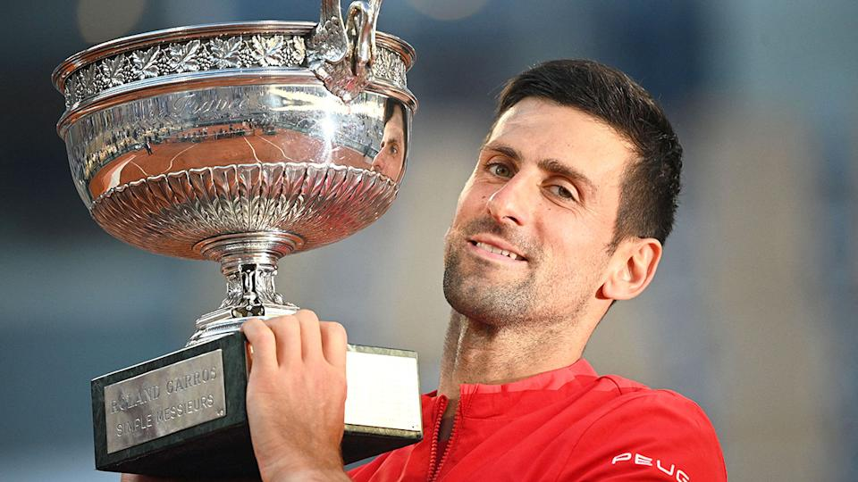 Pictured here, Novak Djokovic holds the French Open trophy aloft.