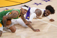 Utah Jazz guard Jordan Clarkson, left, and Los Angeles Lakers guard Wesley Matthews scramble for a loose ball during the first half of an NBA basketball game Saturday, April 17, 2021, in Los Angeles. (AP Photo/Mark J. Terrill)