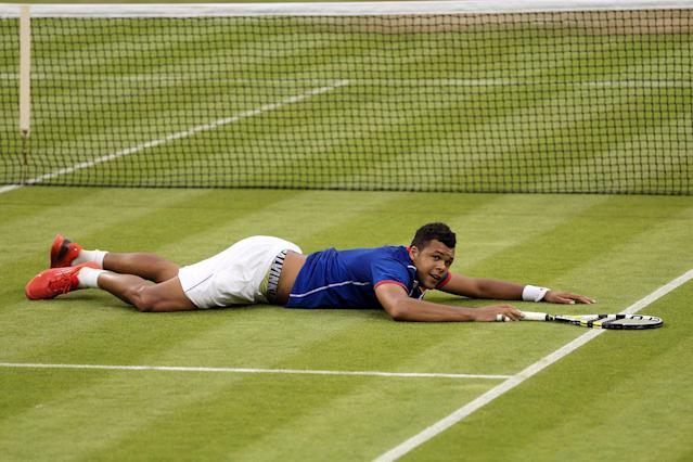 LONDON, ENGLAND - JULY 29: Jo-Wilfried Tsonga of France celebrates match point during the Men's Singles Tennis match against Thomaz Bellucci of Brazil on Day 2 of the London 2012 Olympic Games at the All England Lawn Tennis and Croquet Club in Wimbledon on July 29, 2012 in London, England. (Photo by Clive Brunskill/Getty Images)