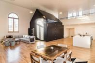 """Back in the 1930s, The Hellena was a church. Circa 2021, the five-bedroom, four-and-a-half-bath conversion mostly attracts architecture lovers. It has sky-high windows and lofty ceilings, of course, but also a full-size tiny house inexplicably plunked in its living room. (The unusual space-within-a-space includes a private bedroom and bath.) If your crew loves to cook, you can spend most of your time gathered around the 13-foot waterfall island in the shiny new kitchen or dancing, <a href=""""https://www.cntraveler.com/gallery/caribbean-cocktails-that-are-easy-to-make-at-home?mbid=synd_yahoo_rss"""" rel=""""nofollow noopener"""" target=""""_blank"""" data-ylk=""""slk:cocktails"""" class=""""link rapid-noclick-resp"""">cocktails</a> in hand, to vinyl played on a stylish Crosley turntable. When you're ready to take the party outside, rest assured there are <a href=""""https://www.cntraveler.com/gallery/best-restaurants-in-denver?mbid=synd_yahoo_rss"""" rel=""""nofollow noopener"""" target=""""_blank"""" data-ylk=""""slk:restaurants"""" class=""""link rapid-noclick-resp"""">restaurants</a>, bars, museums, and movie theaters within walking distance. (If you're looking for a stay elsewhere in Colorado, check out our list of the <a href=""""https://www.cntraveler.com/gallery/best-airbnbs-in-colorado?mbid=synd_yahoo_rss"""" rel=""""nofollow noopener"""" target=""""_blank"""" data-ylk=""""slk:best Airbnbs in the state"""" class=""""link rapid-noclick-resp"""">best Airbnbs in the state</a>.) $459, Airbnb (Starting Price). <a href=""""https://www.airbnb.com/rooms/8800911"""" rel=""""nofollow noopener"""" target=""""_blank"""" data-ylk=""""slk:Get it now!"""" class=""""link rapid-noclick-resp"""">Get it now!</a>"""