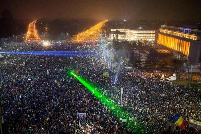 Up to 300,000 people were estimated to have gathered on Sunday in Bucharest's Victory Square, and a half million nationwide, in protest against the government's failed effort to water down corruption laws (AFP Photo/ANDREI PUNGOVSCHI)