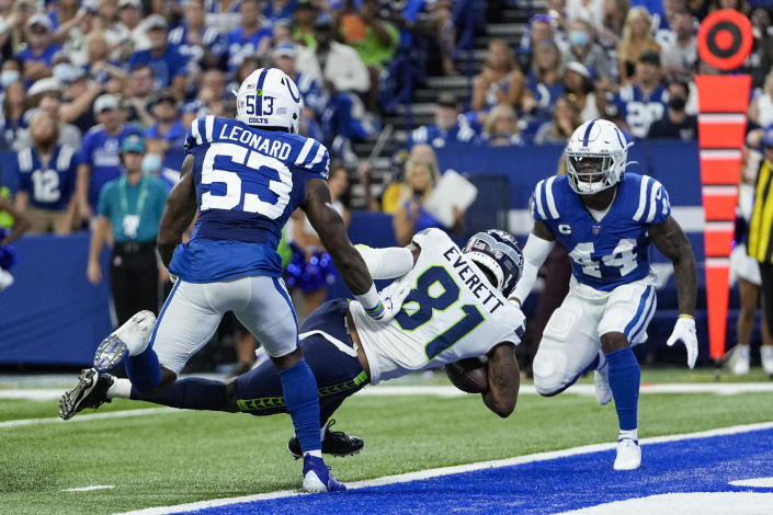 Seattle Seahawks tight end Gerald Everett (81) scores a touchdown between Indianapolis Colts outside linebacker Darius Leonard (53) and outside linebacker Zaire Franklin (44) during the first half of an NFL football game in Indianapolis, Sunday, Sept. 12, 2021. (AP Photo/AJ Mast)