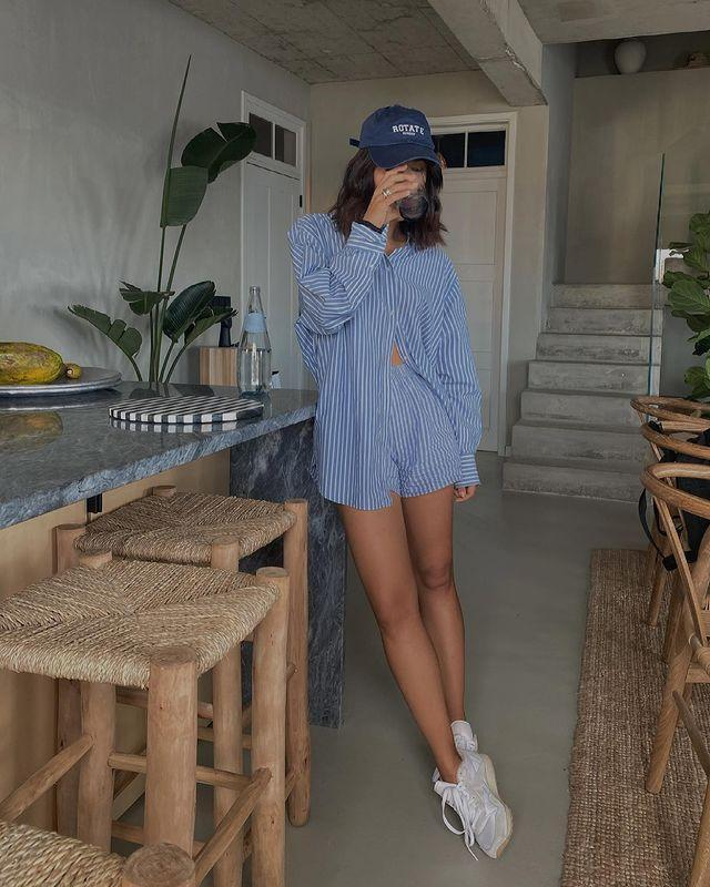"""<p>Oversized button-downs feel fresh—and come alive even more when paired with coordinating shorts. </p><p><a href=""""https://www.instagram.com/p/CMpnJJMBzk4/?igshid=9imqdy87j1q"""" rel=""""nofollow noopener"""" target=""""_blank"""" data-ylk=""""slk:See the original post on Instagram"""" class=""""link rapid-noclick-resp"""">See the original post on Instagram</a></p>"""