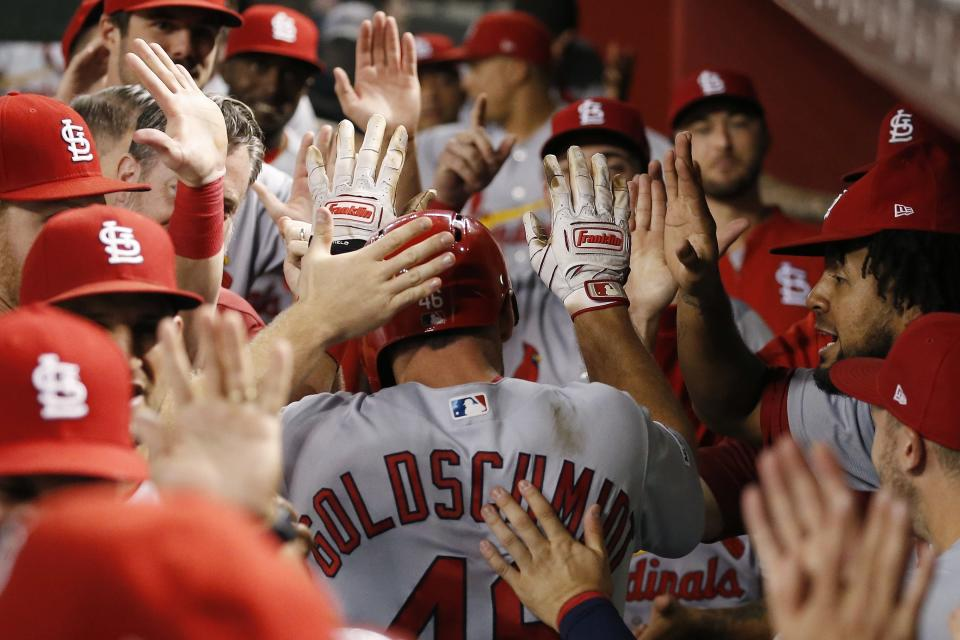 St. Louis Cardinals' Paul Goldschmidt, center, celebrates his two-run home run against the Arizona Diamondbacks during the third inning of a baseball game Monday, Sept. 23, 2019, in Phoenix. (AP Photo/Ross D. Franklin)