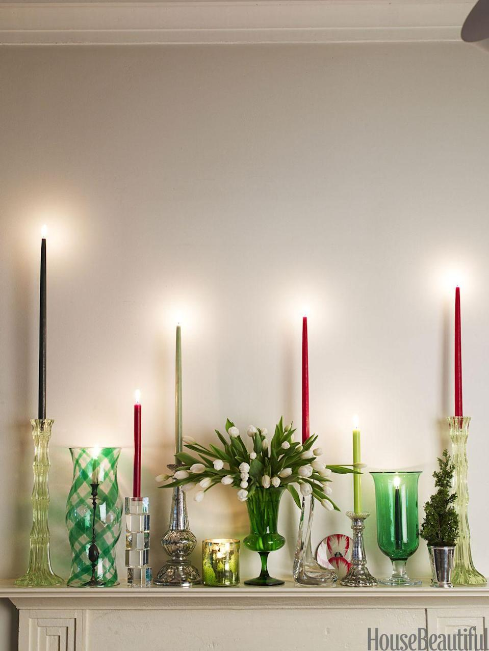 "<p>Instead of a garland, dress up a mantel with a <a href=""https://www.housebeautiful.com/room-decorating/colors/tips/g492/red-and-green-christmas-decorations/"" rel=""nofollow noopener"" target=""_blank"" data-ylk=""slk:mix of candlesticks"" class=""link rapid-noclick-resp"">mix of candlesticks</a> — tall, small, mercury glass, crystal. Instead of ivory candles, opt for red, cranberry, and shades of green. </p>"
