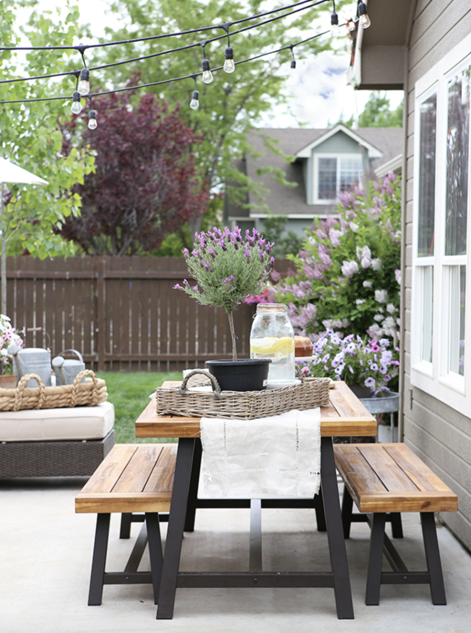 """<p>Host your next garden party in style. A few strands of string lights create a tent-like effect above this outdoor dining table setup that's perfect for spring.</p><p><strong>See more at <a href=""""https://www.ellaclaireinspired.com/summer-patio-makeover-tour/"""" rel=""""nofollow noopener"""" target=""""_blank"""" data-ylk=""""slk:Ella Claire"""" class=""""link rapid-noclick-resp"""">Ella Claire</a>.</strong></p><p><a class=""""link rapid-noclick-resp"""" href=""""https://go.redirectingat.com?id=74968X1596630&url=https%3A%2F%2Fwww.wayfair.com%2Fkeyword.php%3Fkeyword%3Doutdoor%2Bdining%2Bsets&sref=https%3A%2F%2Fwww.countryliving.com%2Fgardening%2Fnews%2Fg3404%2Fbackyard-string-lights%2F"""" rel=""""nofollow noopener"""" target=""""_blank"""" data-ylk=""""slk:SHOP OUTDOOR DINING SETS"""">SHOP OUTDOOR DINING SETS</a></p>"""