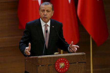 Turkish President Erdogan makes a speech during his meeting with mukhtars at the Presidential Palace in Ankara, Turkey,