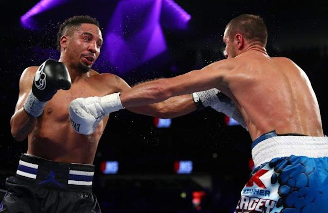 Andre Ward trades punches with Sergey Kovalev during their first fight on Nov. 19, 2016. (Getty Images)