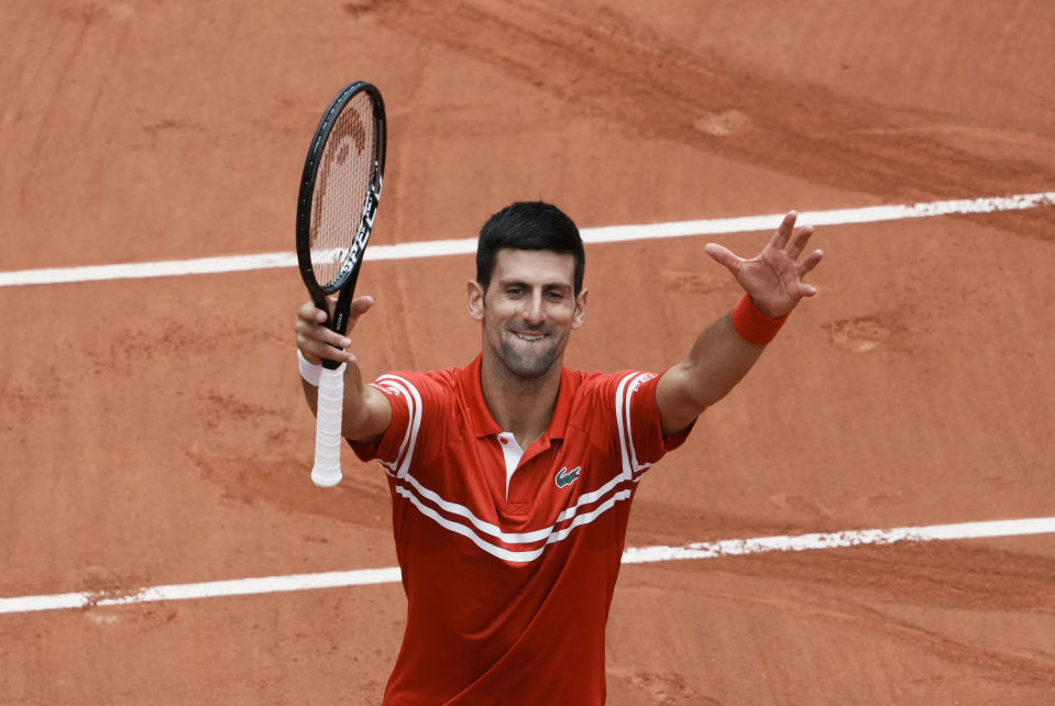 Serbia's Novak Djokovic celebrates towards the crowd after defeating Lithuania's Ricardas Berankis during their third round match on day 7, of the French Open tennis tournament at Roland Garros in Paris, France, Saturday, June 5, 2021. (AP Photo/Thibault Camus)