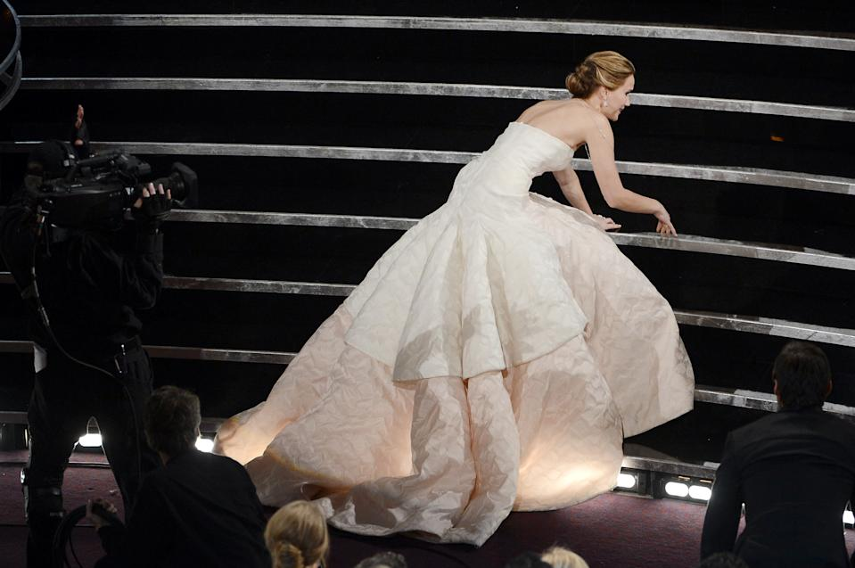 "Jennifer Lawrence fell up the stairs after winning the ""Best Actress"" award for the film ""Silver Linings Playbook"" during the 2013 Academy Awards. (Photo: Kevin Winter/Getty Images)"
