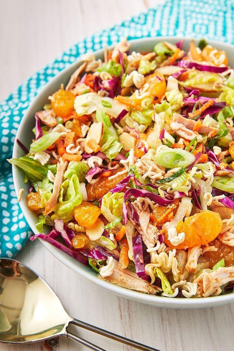"""<p>This Chinese chicken salad is fresh and full of crunchy ramen, sweet mandarins, and crisp cabbage. It's our favourite salad to bring along to any summer bbq and what we make when we need an easy lunch.</p><p>Get the <a href=""""https://www.delish.com/uk/cooking/recipes/a31109543/chinese-chicken-salad-recipe/"""" rel=""""nofollow noopener"""" target=""""_blank"""" data-ylk=""""slk:Chinese Chicken Salad"""" class=""""link rapid-noclick-resp"""">Chinese Chicken Salad</a> recipe.</p>"""