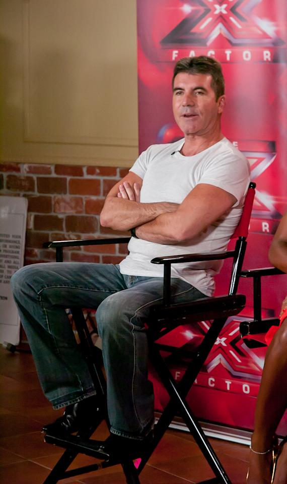 "Simon Cowell attends the ""The X Factor"" Judges press conference at Nassau Veterans Memorial Coliseum on June 20, 2013 in Uniondale, New York."